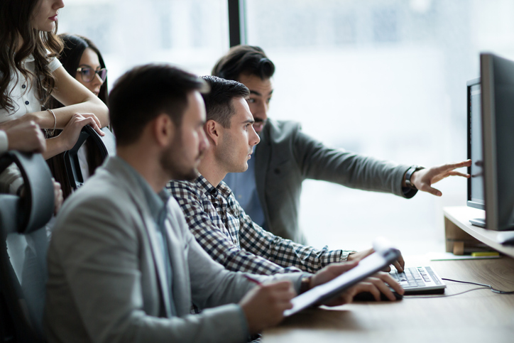 Group of people looking at computer screen